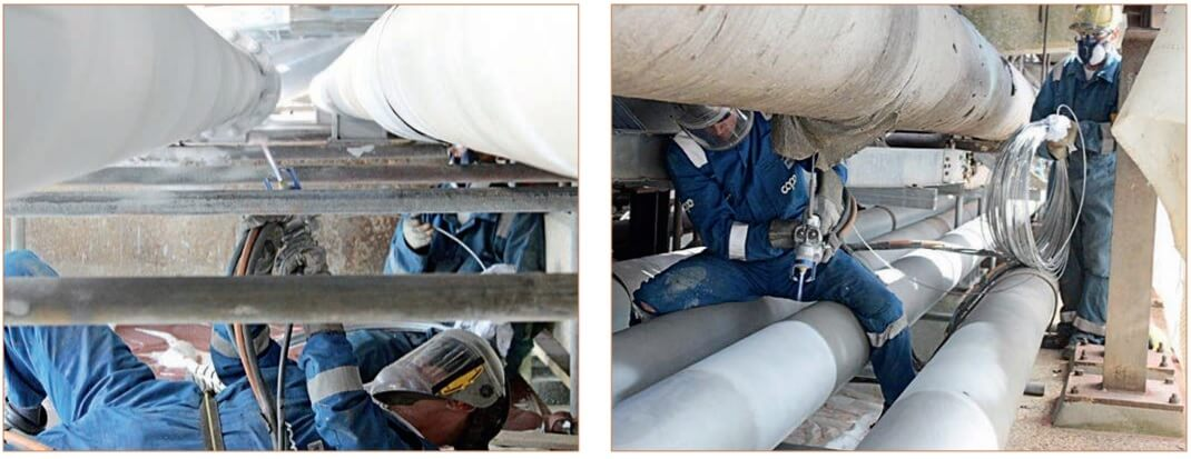Figure 2. Spraying thermal insulation on a pipeline.