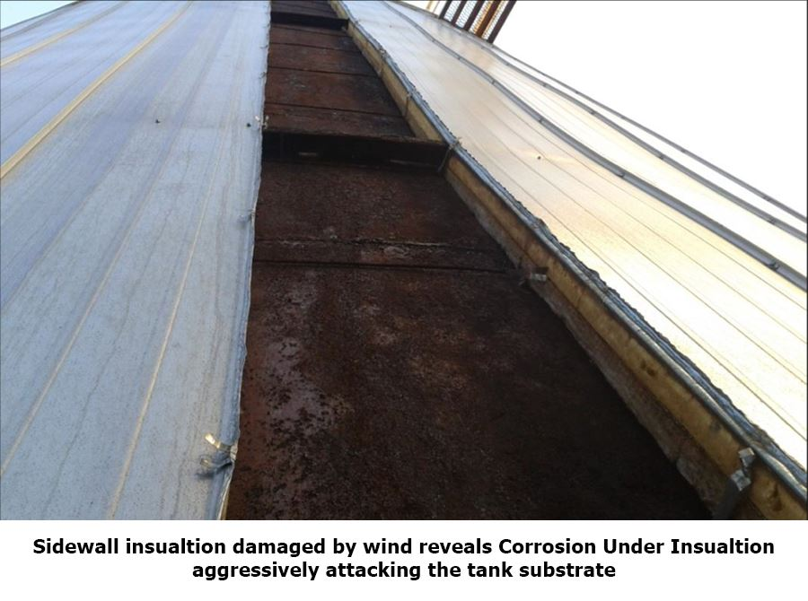 Sidewall insulation damaged by wind reveals corrosion under insulation (CUI).