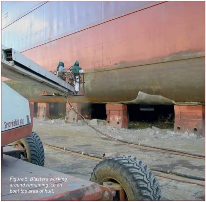 Figure 5. Abrasive blasting ice off the ship's hull.