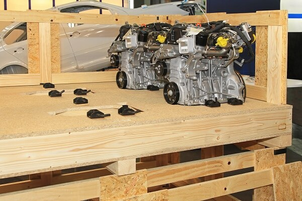 Figure 1. Automotive engine parts being crated for transport.