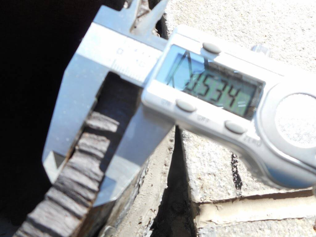 caliper measuring pipe at thickness of 0.534 inches