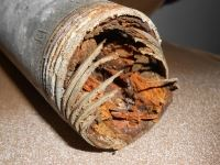 Threaded pipe with corrosion (rust) deposits.