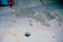 Photo 6. Removal of a delaminated slab surface by shot blasting, after hammer sounding identified zones of drummy concrete.