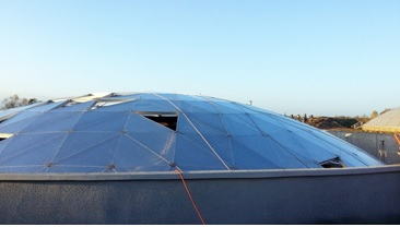 Figure 2. Storage tank with panels removed from geodesic dome roof.