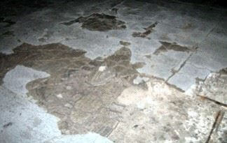 An image of a concrete floor with moisture issues.
