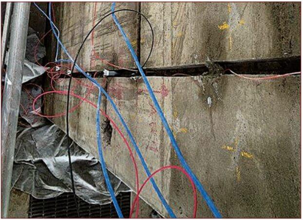 Installing cathodic protection in concrete bridge during repairs.