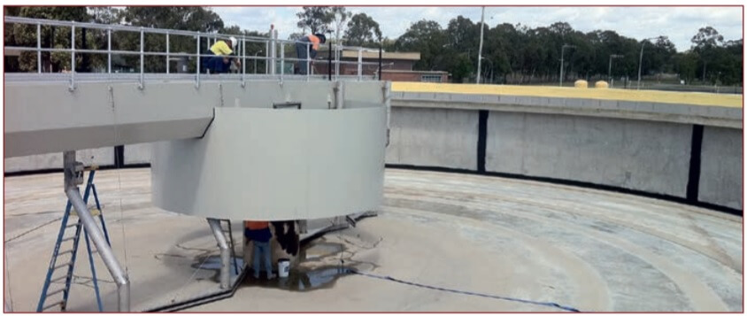 Figure 1. A wastewater treatment plant settlement tank being prepared for protection by a sprayed pure polyurea coating.