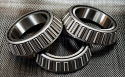 Photograph of metal ball bearings on carbon fiber.