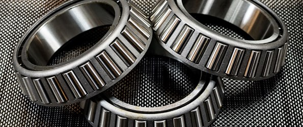 Photograph of metal ball bearings on carbon fiber.