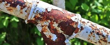 Steel corrosion on a rusty pipe