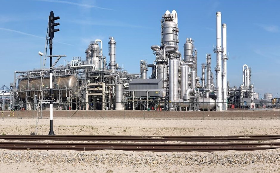 Oil refinery with stainless steel process equipment and pipelines.