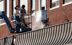 Will using wet abrasive blasting instead of dry eliminate dust?