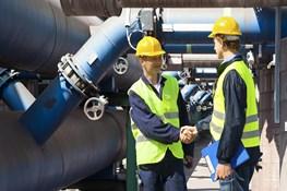 engineers meeting pipes