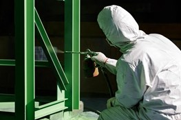 What is a plural component protective coating and what is it used for?