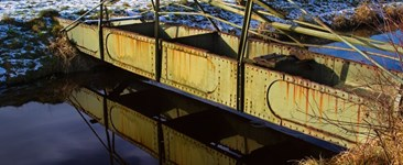 The Relationship Between Corrosion Fatigue and Stress Corrosion Cracking