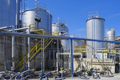 Paper mill with stainless steel process vessels.