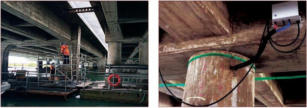 Repairing and installing cathodic protection to concrete bridge.