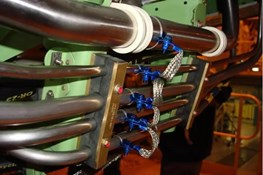 Blue-tinted liquid nylon multipolymer coating in use on hydraulic grounding connections.